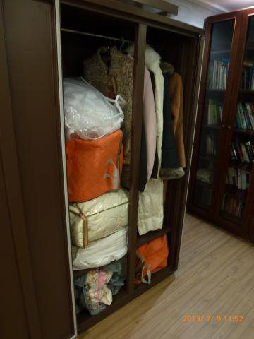 Clothing stored in Eureka Dry Tech's Wardrobe dry cabinet