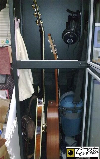 Guitars and accessories protected in Eureka Dry cabinet from humidity damage, moisture damage