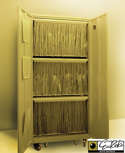 Eureka SMT Dry Cabinet storing PCB film negatives.
