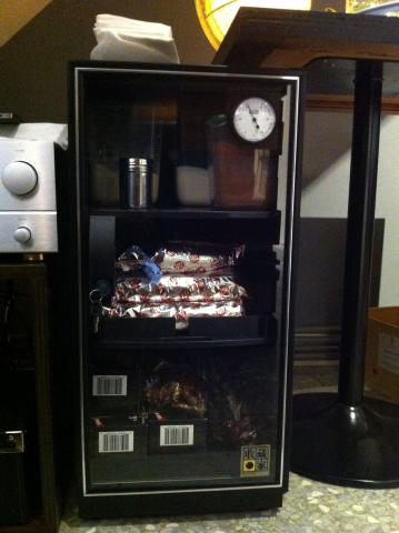 Eureka Dry Cabinet used to store food items in a bar.